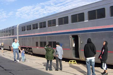 Amtrak train at station with passengers standing alongside